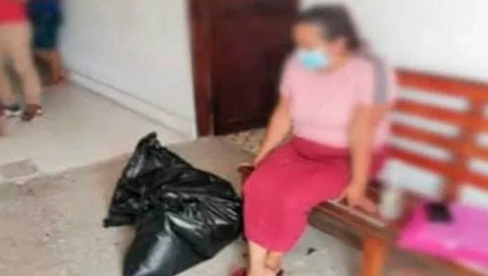 Mujer con restos de víctima de desaparición